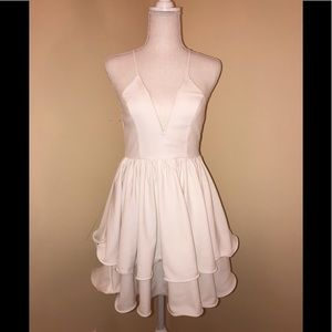 White cocktail dress with tiered skirt
